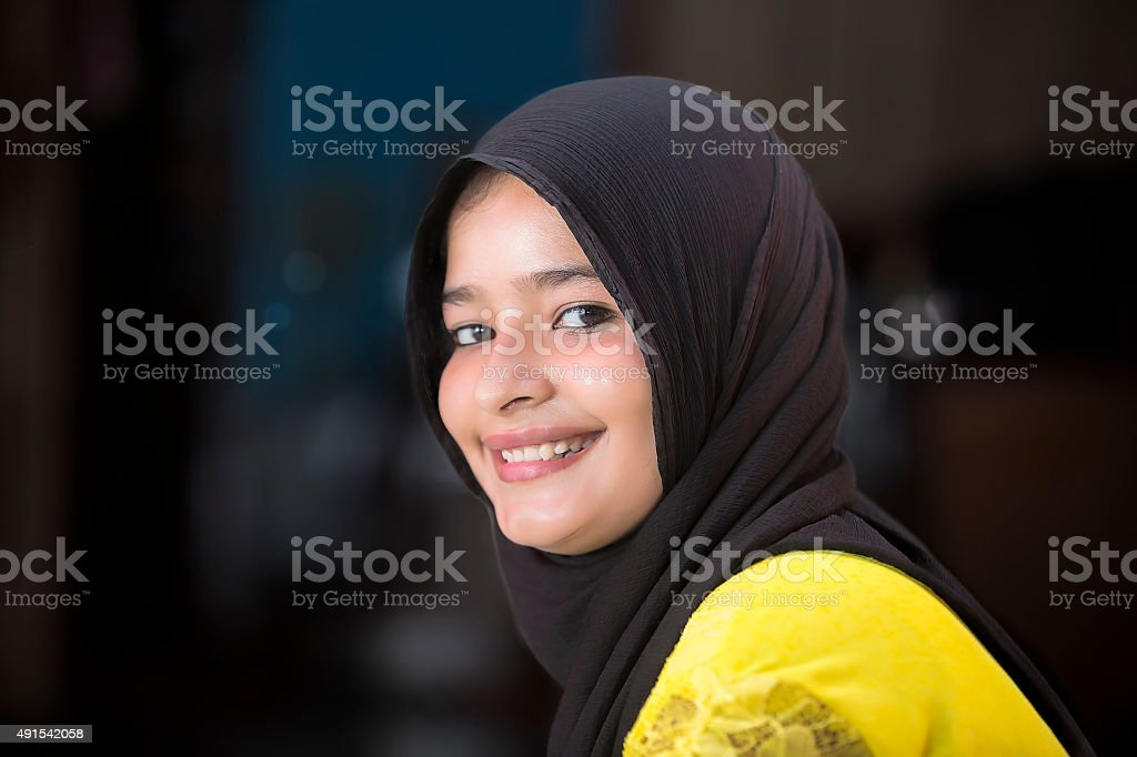 Portrait of a young Muslim woman with traditional headscarf stock photo