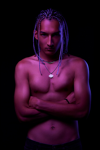 Portrait Of A Young Naked African Man At Studio. High Fashion Male Model In Colorful Neon Bright