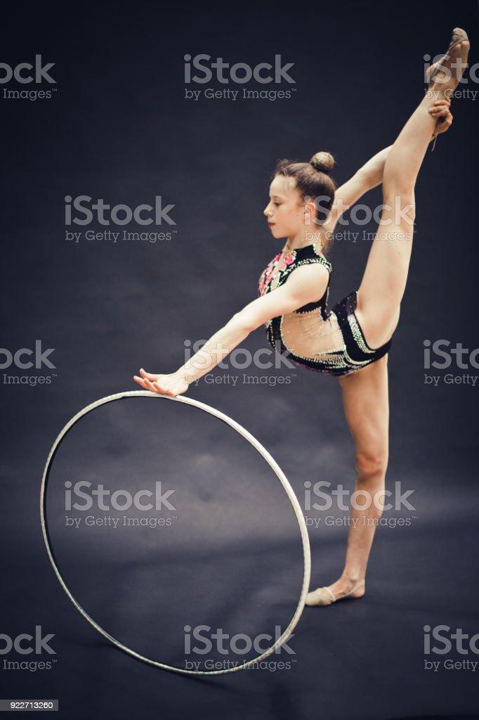 Portrait of a Young Rhythmic Gymnastics Athlete on Black Background.