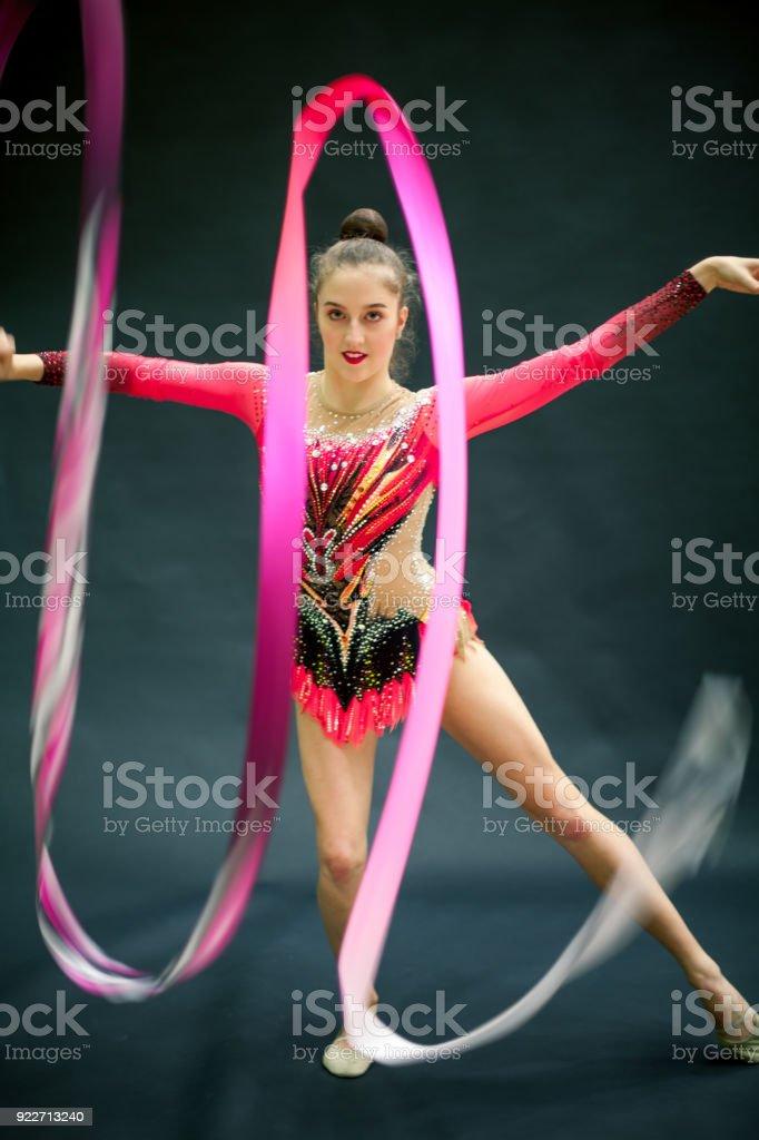 Portrait of a Young Rhythmic Gymnastics Athlete with Ribbon.