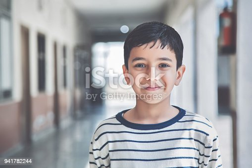 941782244 istock photo Portrait of a young school boy smiling 941782244