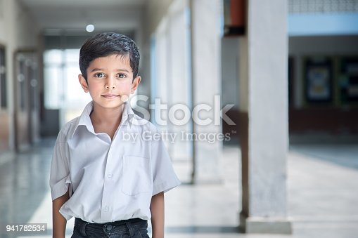 941782244 istock photo Portrait of a young school boy smiling 941782534
