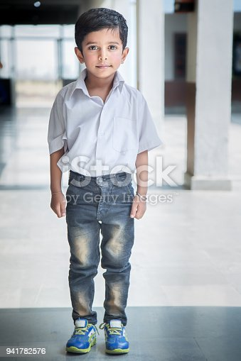 941782244 istock photo Portrait of a young school boy smiling 941782576