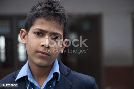 941782244 istock photo Portrait of a young school boy smiling 941782900