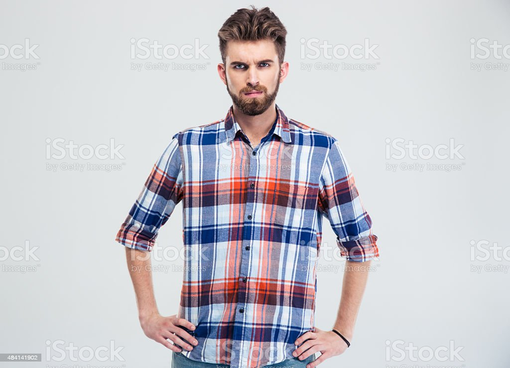 Portrait of a young serious man looking at camera stock photo