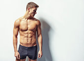 istock Portrait of a young sexy muscular man 496238511