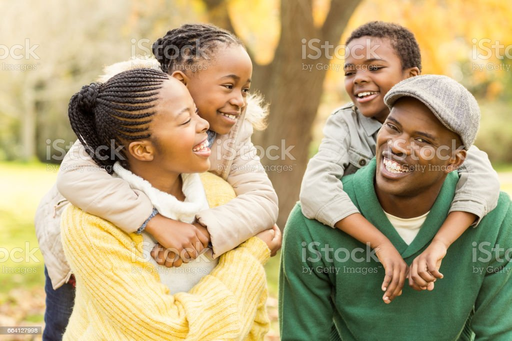 Portrait of a young smiling family in piggyback foto stock royalty-free