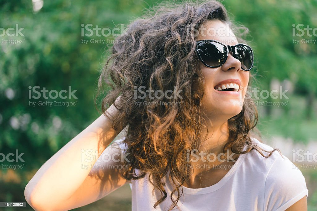 Portrait of a young smiling happy woman in sunglasses stock photo