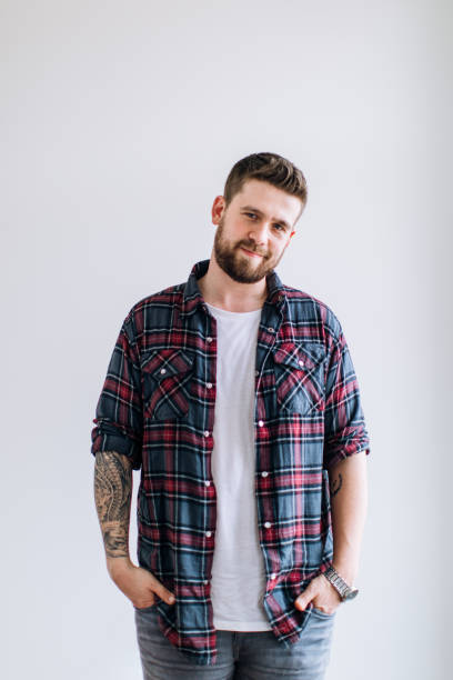 Portrait of a young social worker. Male with casual clothes and tattoo Portrait of a young social worker. Male with casual clothes and tattoo plaid shirt stock pictures, royalty-free photos & images
