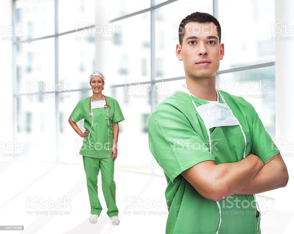 Portrait of a young surgeon and his assistant stock photo