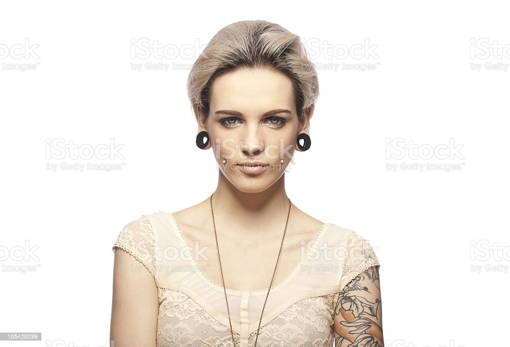 Portrait of a young tattooed woman stock photo