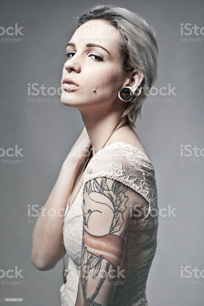 Portrait of a young tattooed woman royalty-free stock photo