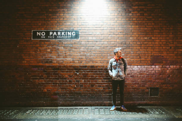 Portrait of a young tourist man on the streets of London at night stock photo