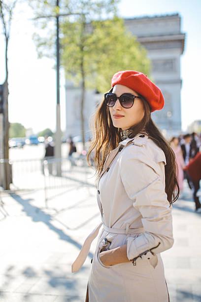 portrait of a young tourist woman walking in paris - paris fashion stock photos and pictures