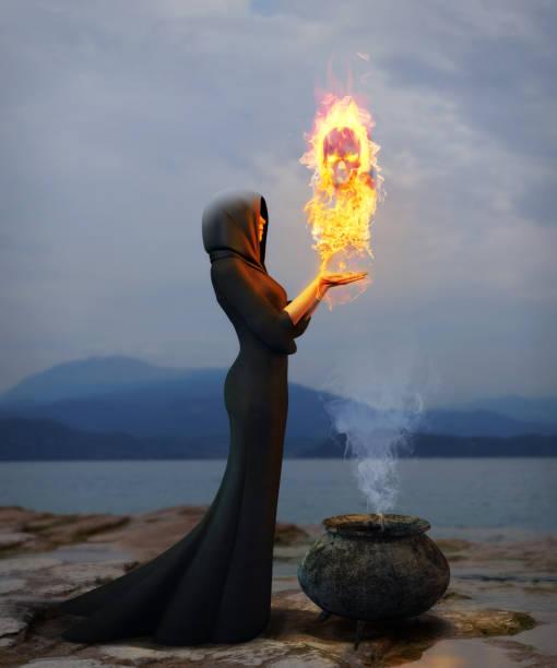 porträt einer jungen hexe, die schaffung eines brennenden schädels - gothic kleid stock-fotos und bilder