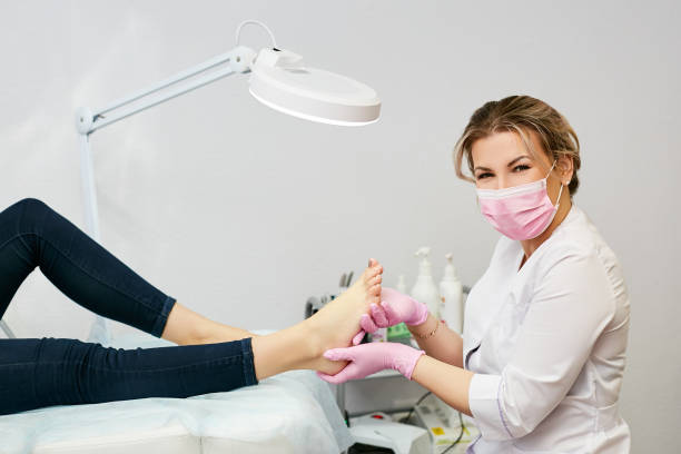 Portrait of a young woman doing the pedicure in a salon. Portrait of a young woman doing the pedicure in a salon. podiatry stock pictures, royalty-free photos & images