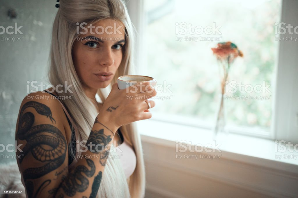 Portrait of a young woman drinking coffee in the morning stock photo