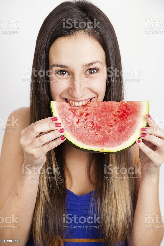 Portrait of a young woman eating with water melon royalty-free stock photo