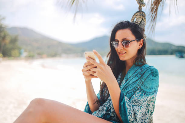 Portrait of a young woman enjoying the tropical paradise on Koh Phangan island in Thailand stock photo
