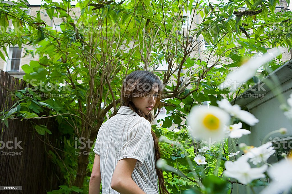 Portrait of a young woman in a garden royalty-free stock photo