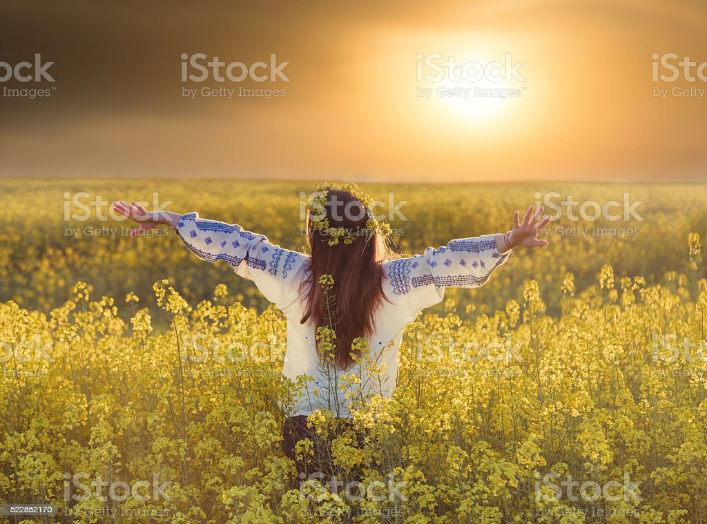 Portrait of a young woman in a rapeseed field stock photo