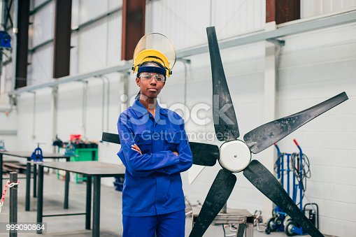 istock Portrait of a Young Woman in an Engineering Workshop 999090864