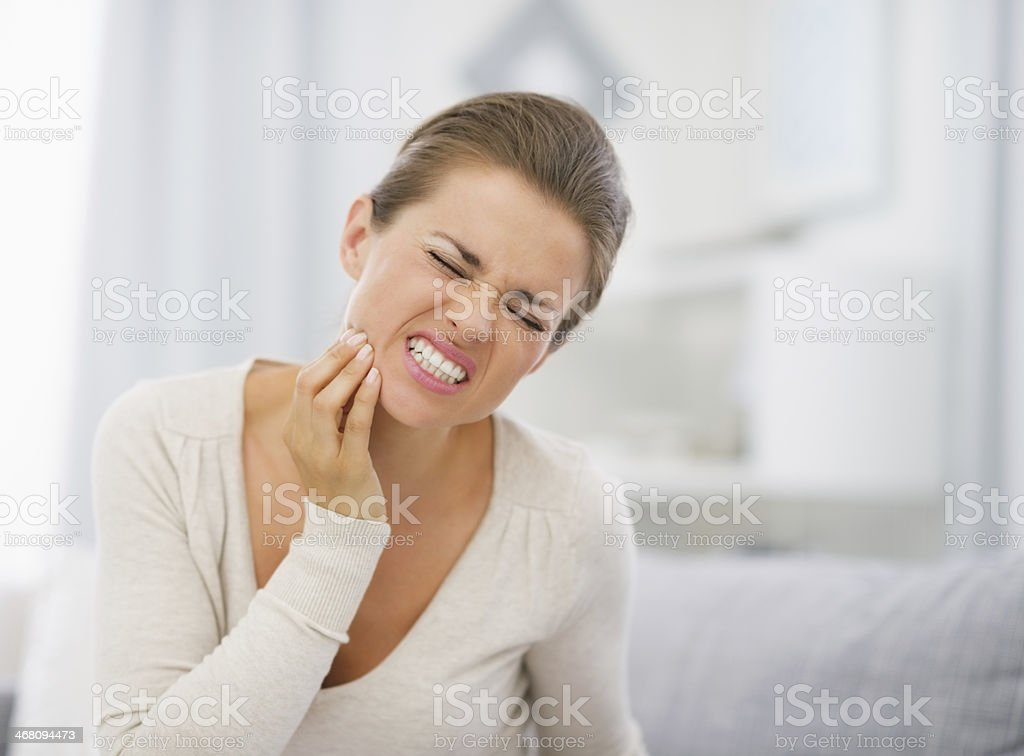 Portrait of a young woman in pain with a toothache stock photo