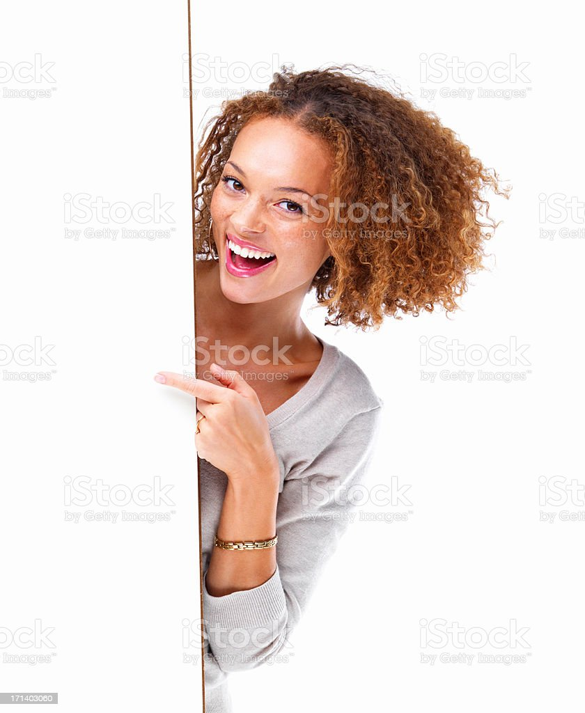 Portrait of a young woman laughing by a blank board isolated on white background stock photo
