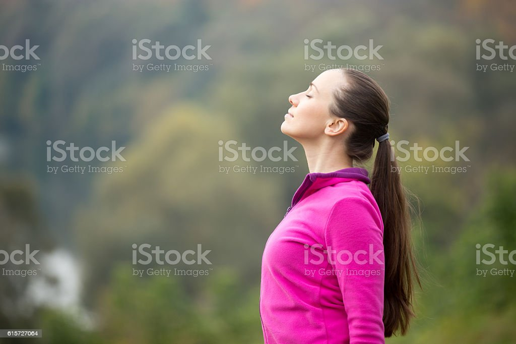 Portrait of a young woman outdoors in sportswear, head up stock photo