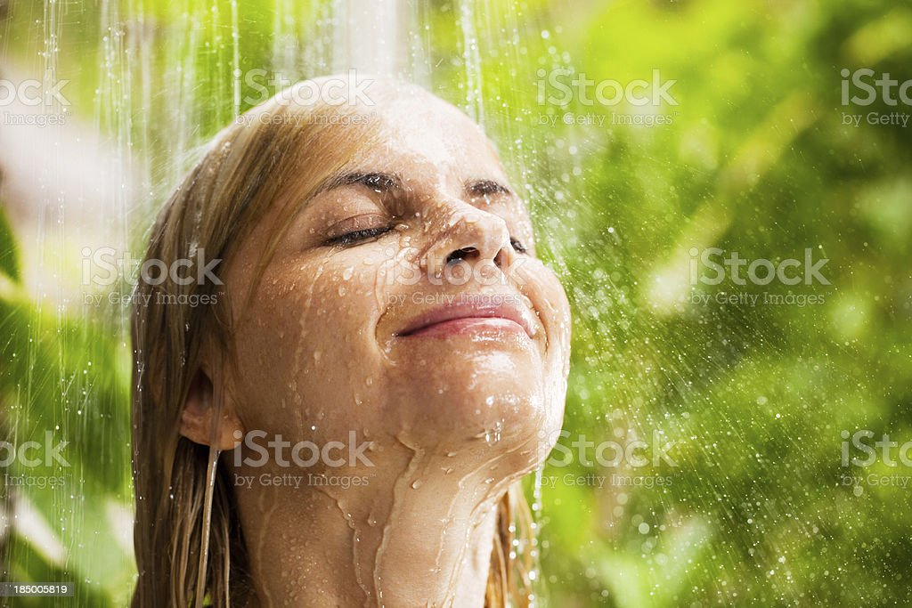 Portrait of a young woman showering outdoor. royalty-free stock photo