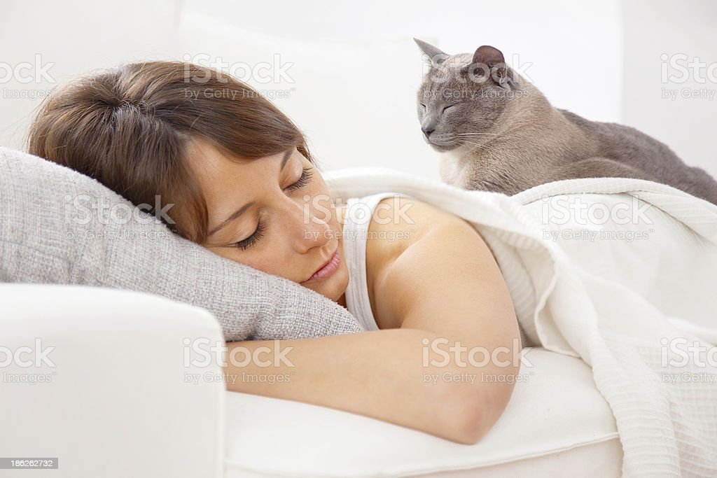 Portrait of a young woman sleeping on the bed stock photo