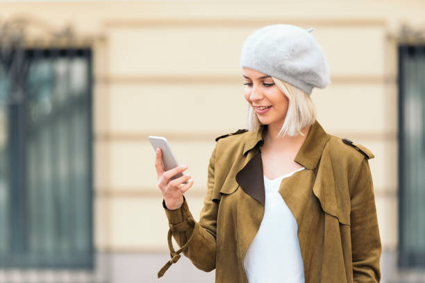 Portrait of a Young woman using her mobile phone. stock photo