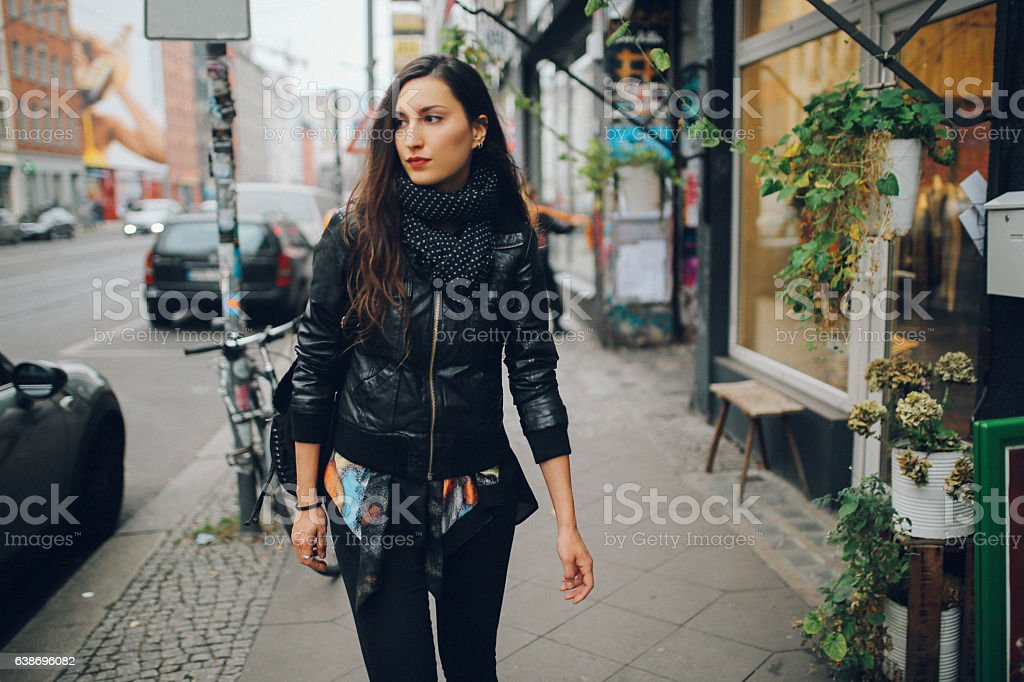 Portrait of a young woman walking in Berlin Schoeneberg district stock photo