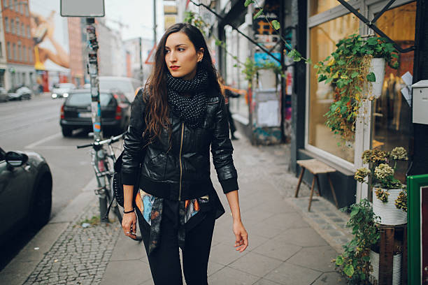 portrait of a young woman walking in berlin schoeneberg district - berlin street bildbanksfoton och bilder