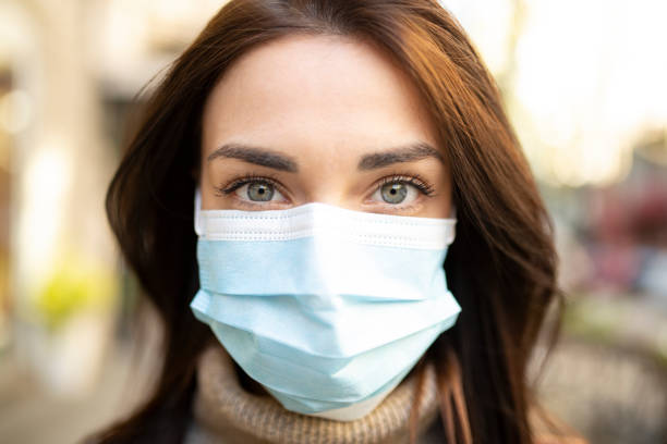 Portrait of a young woman wearing a face mask stock photo