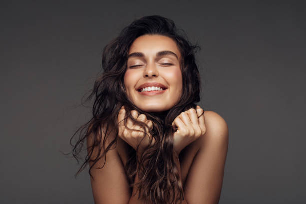 Portrait of a young woman with a beautiful smile Portrait of a young woman with a beautiful smile long hair stock pictures, royalty-free photos & images
