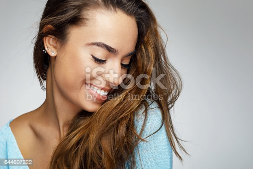 istock Portrait of a young woman with a beautiful smile 644607222
