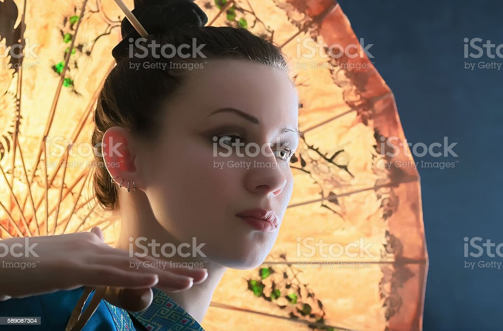 Portrait of a young woman with a Chinese umbrella royalty-free stock photo