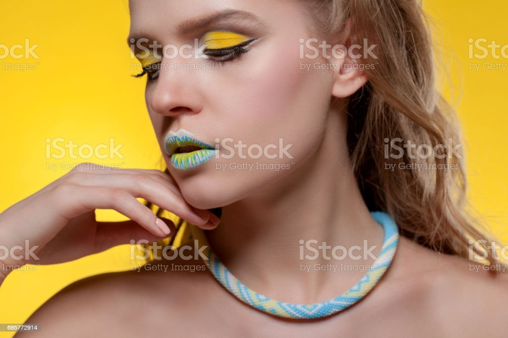 Portrait of a young woman with a creative make-up royalty-free stock photo