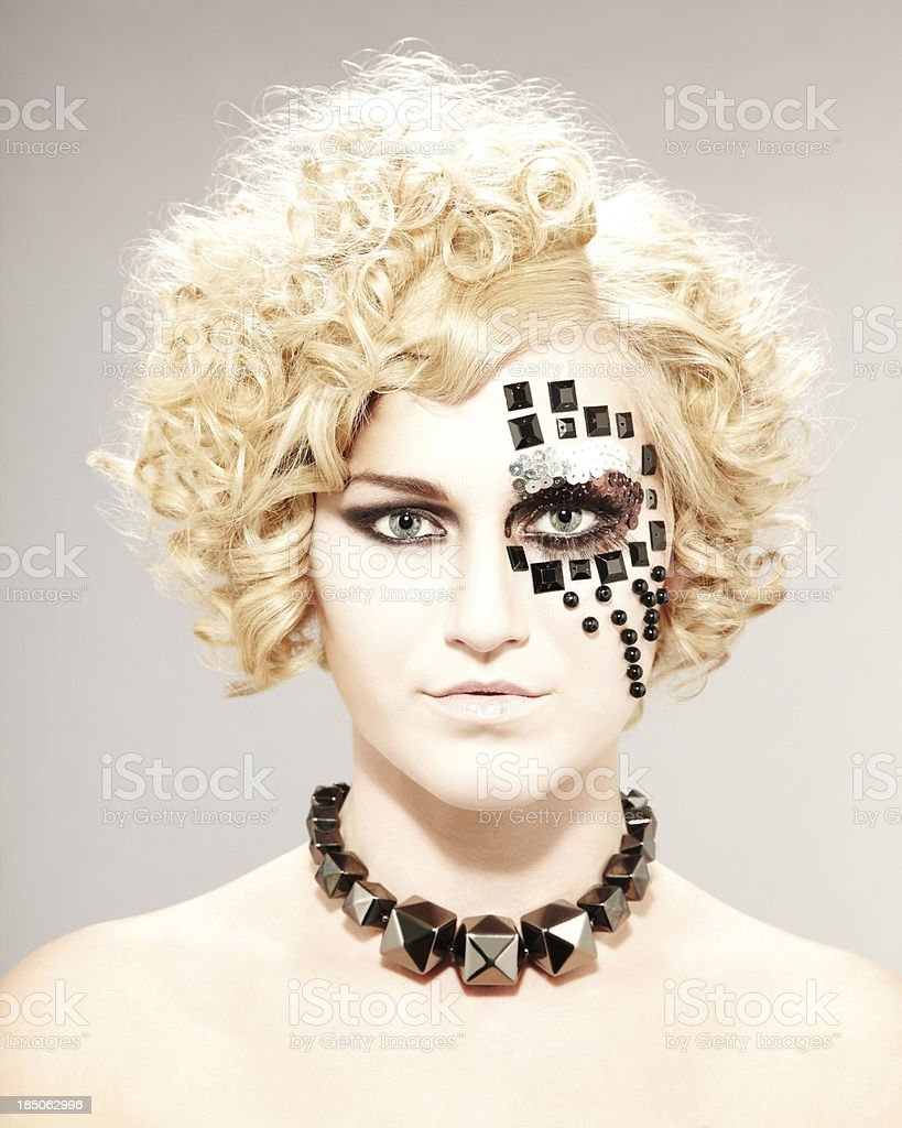 Portrait of a young woman with bead design on face royalty-free stock photo