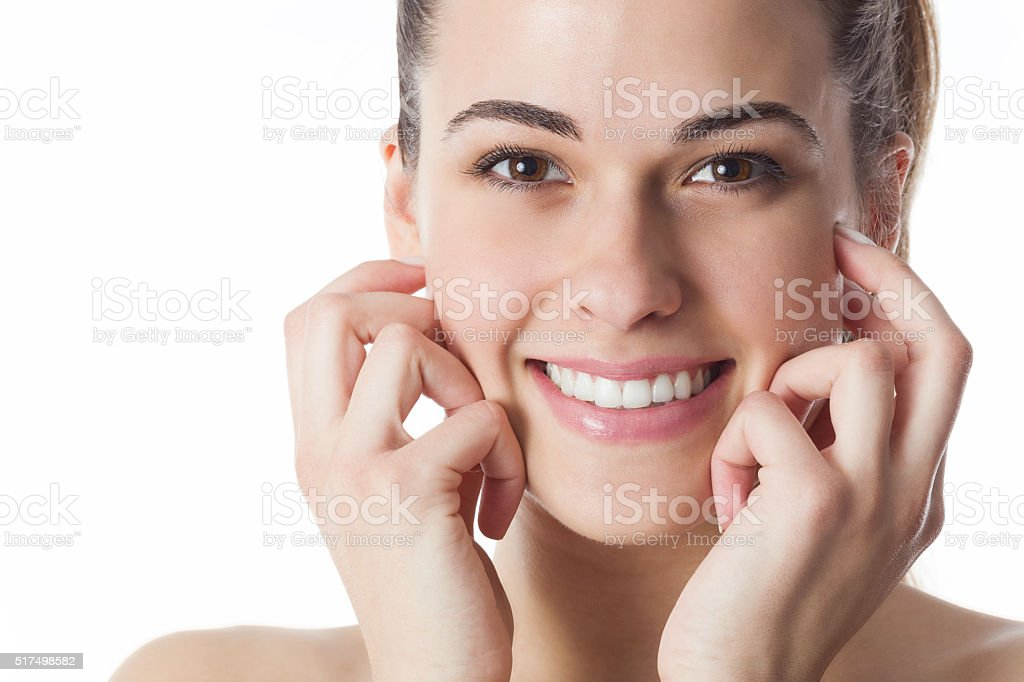 Portrait of a young woman with beautiful smile stock photo