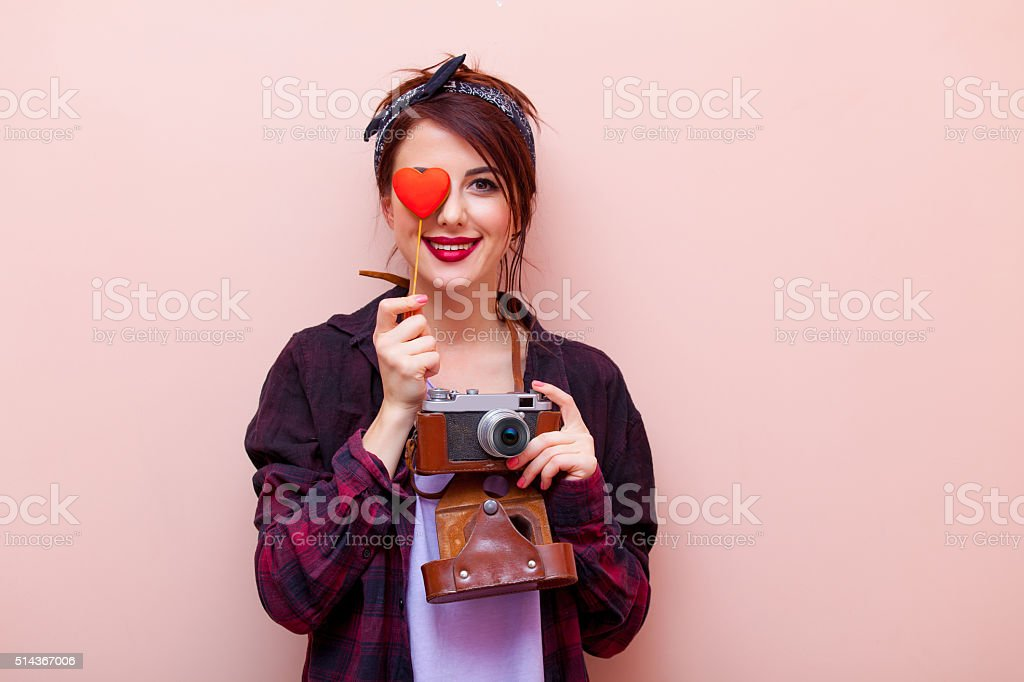 portrait of a young woman with camera and toy stock photo