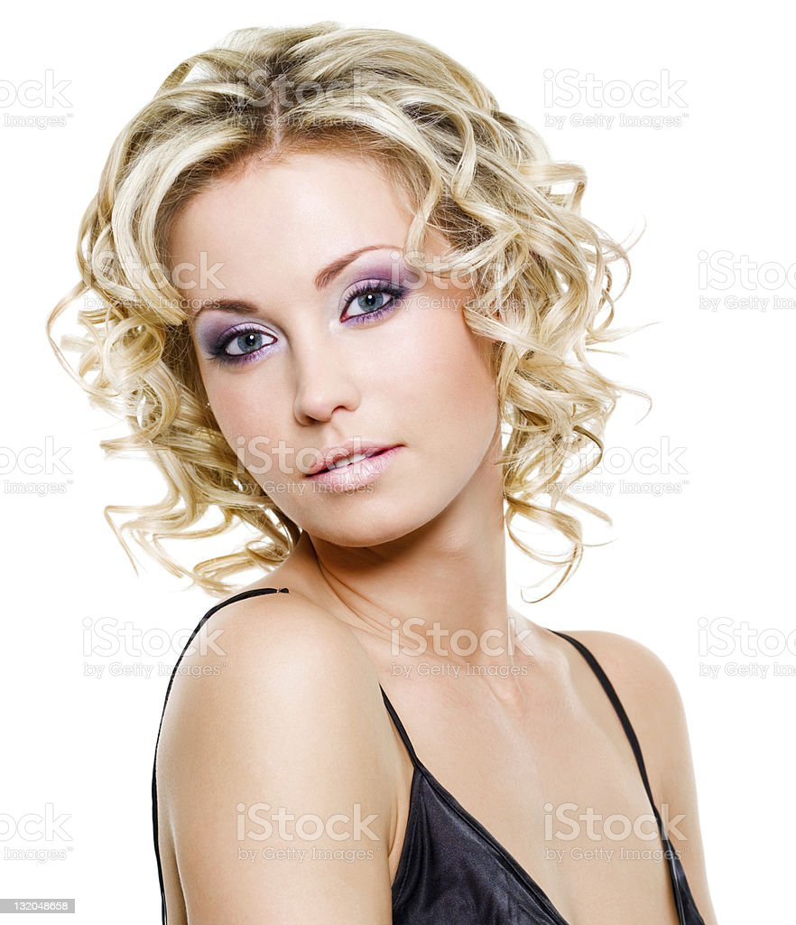 Portrait of a young woman with curly blonde hair royalty-free stock photo