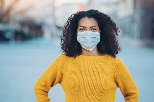 Portrait of a young woman with face mask stock photo