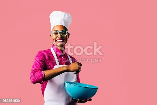 istock Portrait of a young woman with hat and glasses 965551830