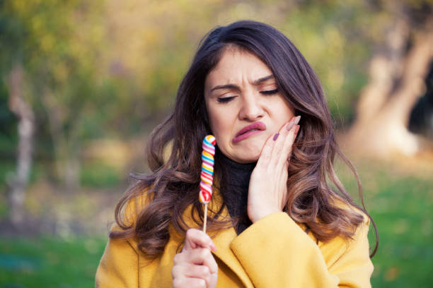 Portrait of a young woman with lollipop stock photo