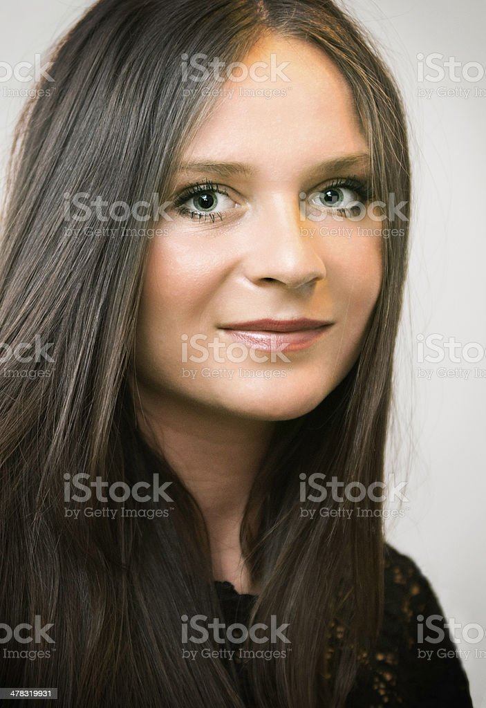 Portrait of a young woman with long brown hair stock photo