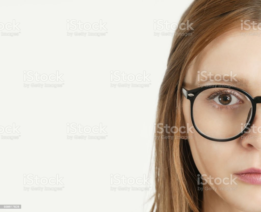 Portrait of a young woman with reading glasses looking at camera stock photo