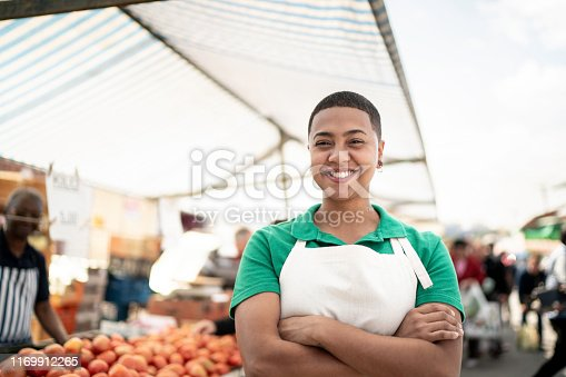 Portrait of a young woman working in a street market