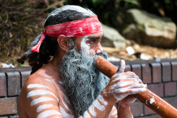 portrait of aboriginal male with didgeridoo, sydney australia, copy space - didgeridoo stock photos and pictures